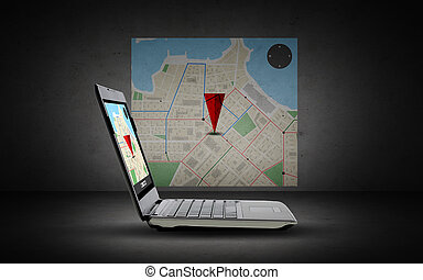 laptop computer with gps navigator map on screen -...
