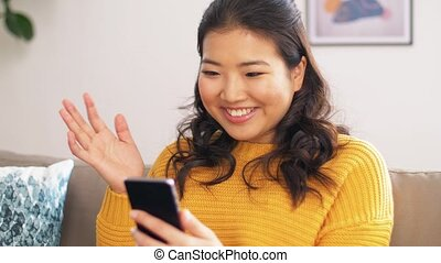 asian woman with smartphone having video call