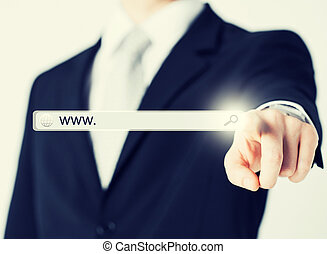 businessman pressing Search button