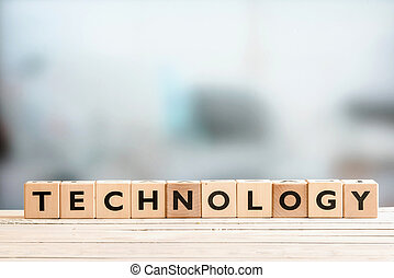 Technology sign on a wooden desk