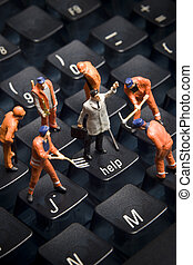 Technology support - Worker figurines posed to look as...