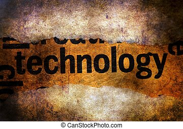 Technology text on torn paper