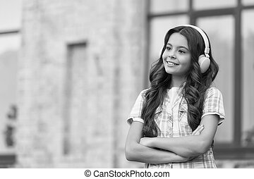 Technology to improve language learning. Happy child wear headphones. Foreign language courses. English school. Audio lesson. Non-formal education. Private teaching. Listening to learn, copy space.