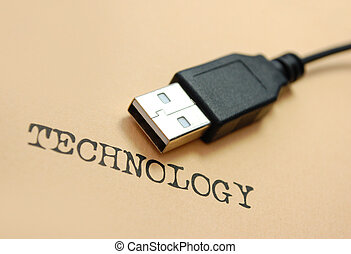 USB cable near to the word technology typed in an old font