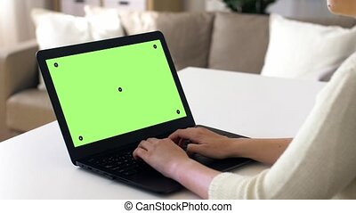 woman with chroma key green screen on laptop - technology,...