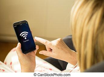 Technology woman free wifi smartphone - modern technology...