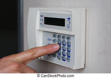 teclas, alarme, apertando, dedo, keypad
