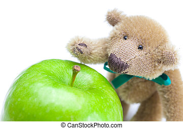 teddy bear and  apple  isolated on white