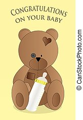 Teddy bear and baby bottle of milk
