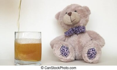Teddy bear and beer, alcohol and toy on a white background