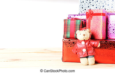 Teddy bear and gift box with wooden table on white backgrounds
