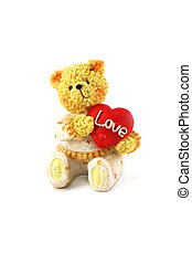 teddy bear and red heart on white background
