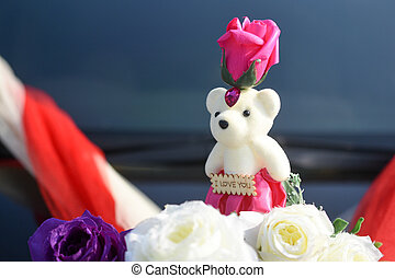 Teddy bear decoration on the wedding car