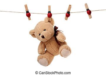 Teddy bear hanging on clothesline - Small teddy bear hanging...