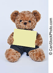 Teddy bear holding a blank sign