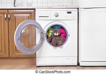 Teddy bear in a washing machine.