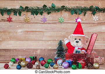 Teddy Bear in Santa Cross Dress with gift box - A photo of...