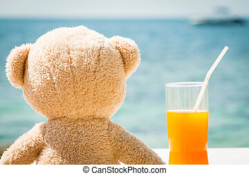 Teddy Bear Looking Out To Sea From Beach