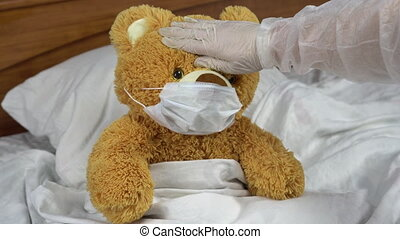 Teddy bear measure the temperature by hand. The doctor makes a measurement of temperature by applying a hand to his forehead. The doctor shows a thumbs up means that the temperature is elevated. 4k