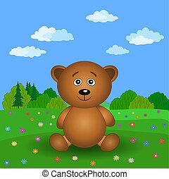 Teddy bear on a summer flower meadow