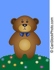 Teddy bear on meadow