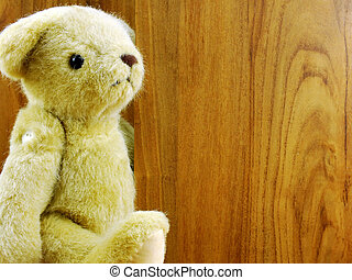 teddy bear on wooden background with space copy