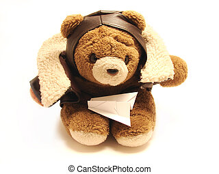 teddy bear pilot with an paper airplane isolated in a white...