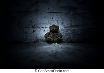 Teddy bear sitting in haunted house, Scary background for book cover