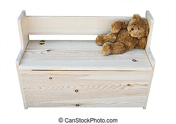 Teddy bear sitting on a childs toy box isolated on a white background