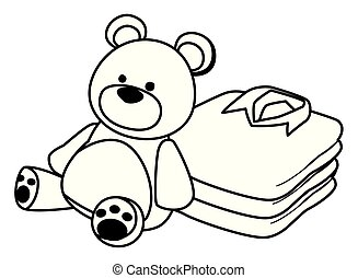 teddy bear toy and folded clothes black and white
