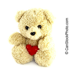 teddy bear toy with heart on white background