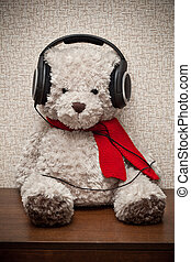 Teddy bear with a red scarf