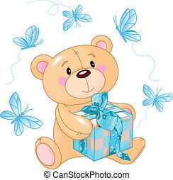 Teddy Bear with blue gift - Cute Teddy Bear sitting with...
