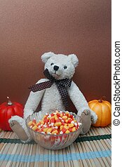 Teddy bear with bowl of candy corn