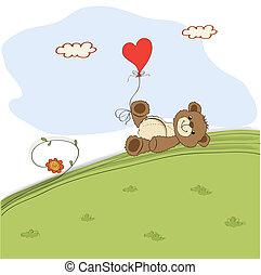 teddy bear with heart on meadow