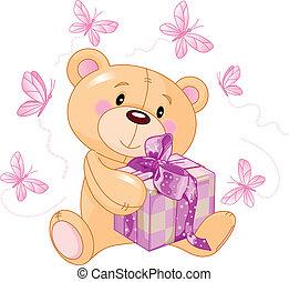 Teddy Bear with pink gift - Cute Teddy Bear sitting with...