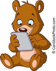 Teddy bear with tablet - Sitting teddy bear using a tablet...