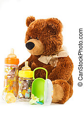 teddy bears and baby bottles and pacifiers for a child