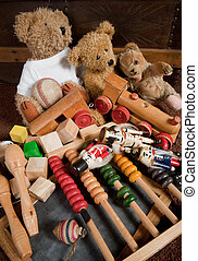 Teddy bears and old toys - Abandoned old toys against an...