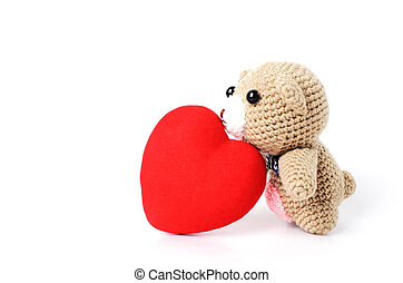 Teddy bears doll kiss red heart shaped Isolated on white background