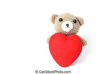 Teddy bears doll with red heart shaped Isolated on white backgrounds