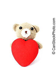 Teddy bears doll with red heart shaped Isolated on white backgrounds vertical side