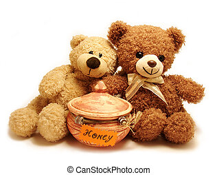 two teddy-bears sitting near the pot with honey.