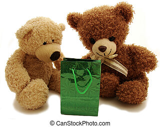 two teddy bears and present isolated in white
