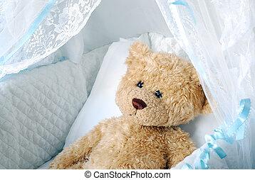 Teddy in crib - Teddy bear inside of a baby bassinet
