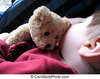 teddy - sleeping child cuddling a teddy bear