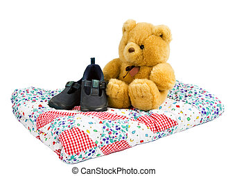 teddy - Teddy bear sitting on a quilted blanket with toddler...