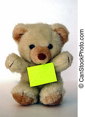 Teddy with a message - A teddy bear with a sticky against a...