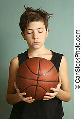 teeb boy with basketball ball