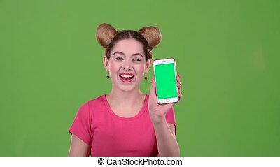 Teen advertises the phone and shows a thumbs up. Green screen. Slow motion
